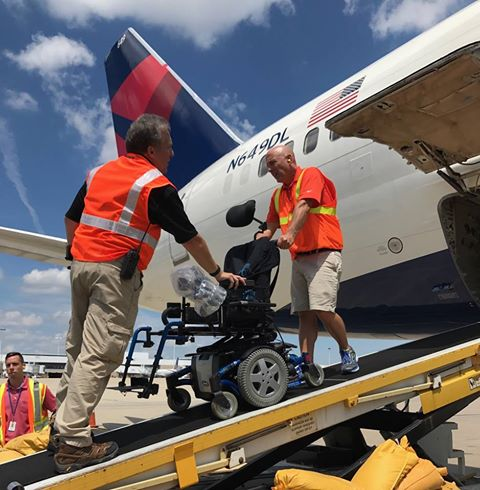 Invacare was at the airport to help unload veterans' wheelchairs from airplanes.