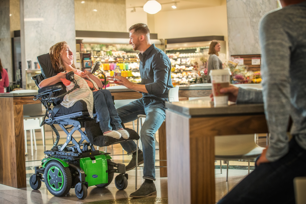 Invacare TDX SP2 Power Wheelchair Elevated with Motion Concepts Ultra Low Maxx Power Positioning System(2).png
